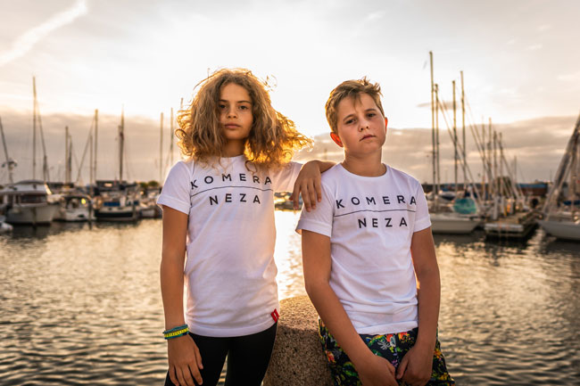 kids white t-shirt with black komera neza logo