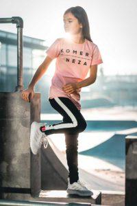 kids pink t-shirt with black komera neza logo