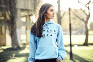 womens blue hoodie with black komera neza print logo