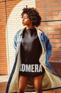 womens black exclusive t-shirt with white komera neza logo print