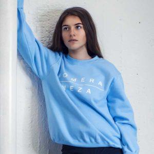 womens baby blue sweatshirt with white komera neza print logo