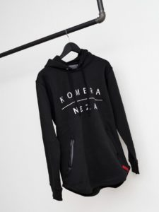 black zipper hoodie with white komera neza print logo