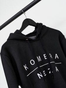 black zipper hoodie with white komera neza print logo