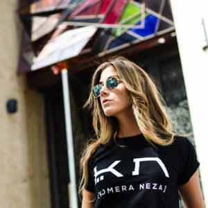 womens black t-shirt with white komera neza print logo