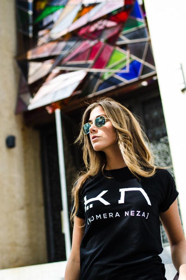 womens black t-shirt with white komera neza print logo