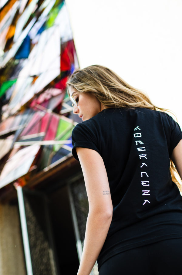 womens black komera neza t-shirt with white print logo