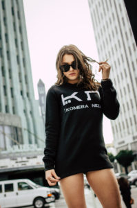 women's black logo sweatshirt with embroidered komera neza logo