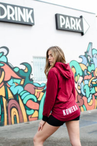 womens burgundy pocketless hoodie with white komera neza print logo