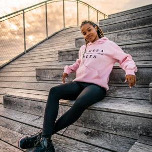 kids pink hoodie with black komera neza print logo