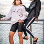 womens white and black zipper hoodie with komera neza print logo