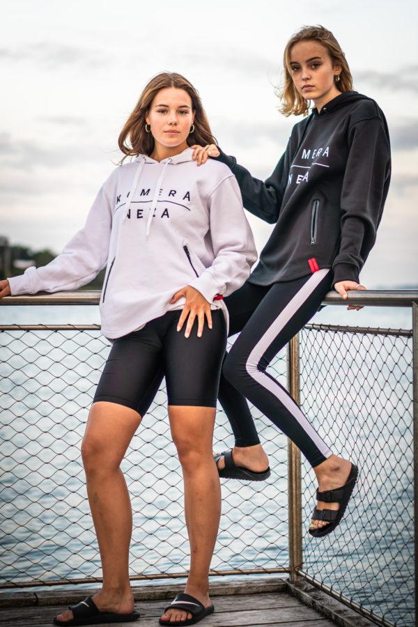 womens white and black zipper hoodie with komera neza print logo