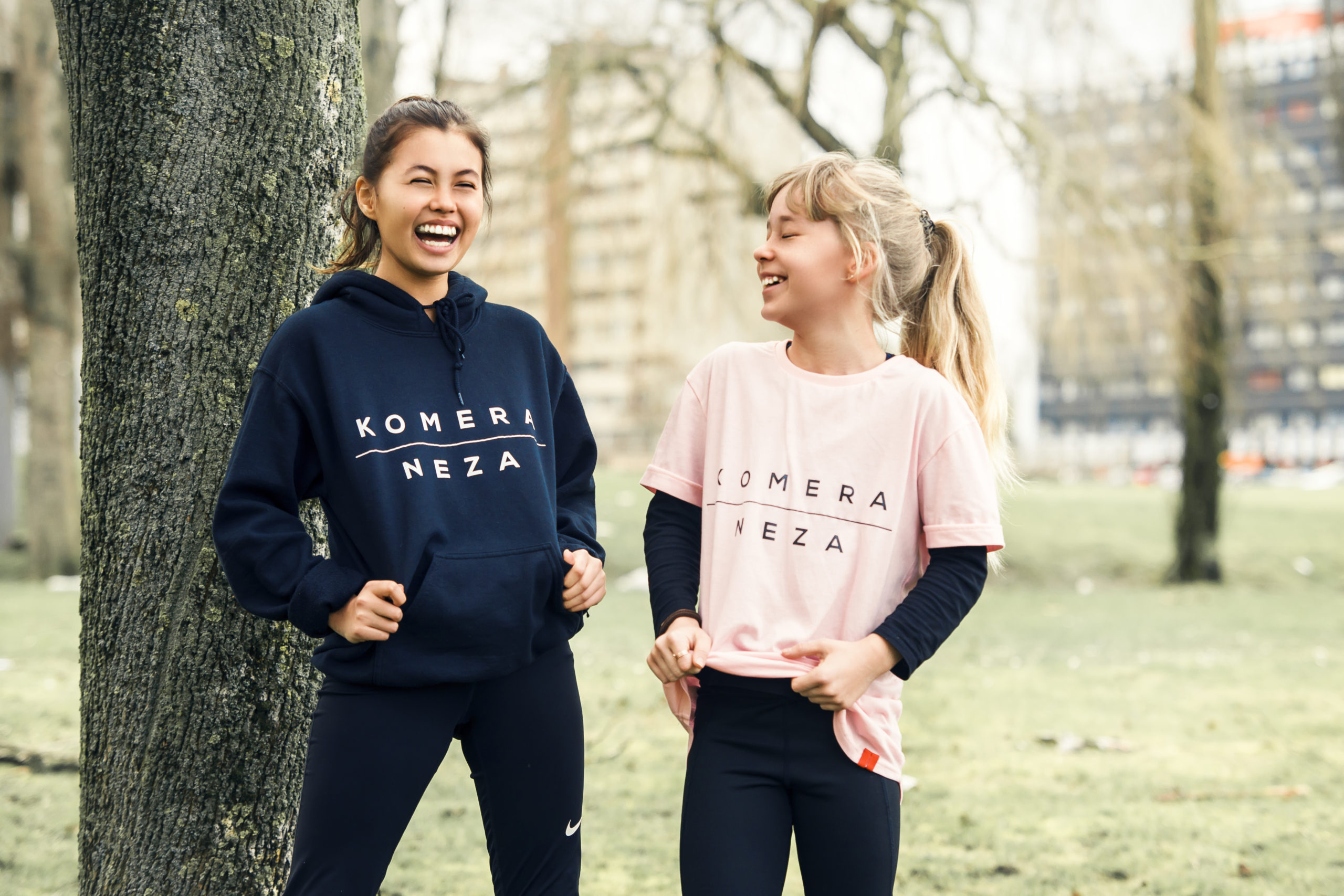 kids black hoodie with white print logo and pink t-shirt with black print komera neza logo