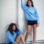womens baby blue sweatshirt with embroidered white komera neza logo