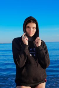womens black hoodie with komera neza print logo