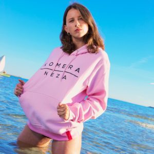 womens pink hoodie with black komera neza print logo
