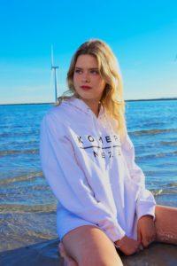 womens white hoodie with black komera neza print logo