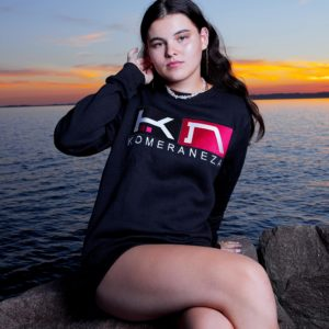 womens black sweatshirt with embroidered komera neza studios logo