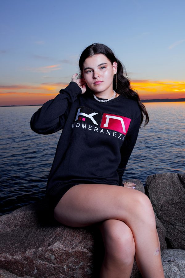 womens black sweatshirt with embroidered komera neza studios logo