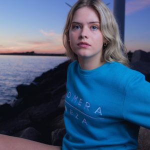 women's blue logo sweatshirt with embroidered komera neza logo