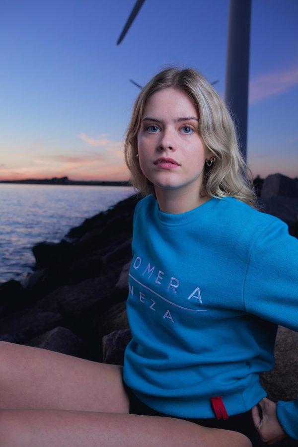 women's blue logo sweatshirt with embroidered komera neza logo