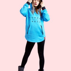 woman wearing blue zipper hoodie with black komera neza print logo