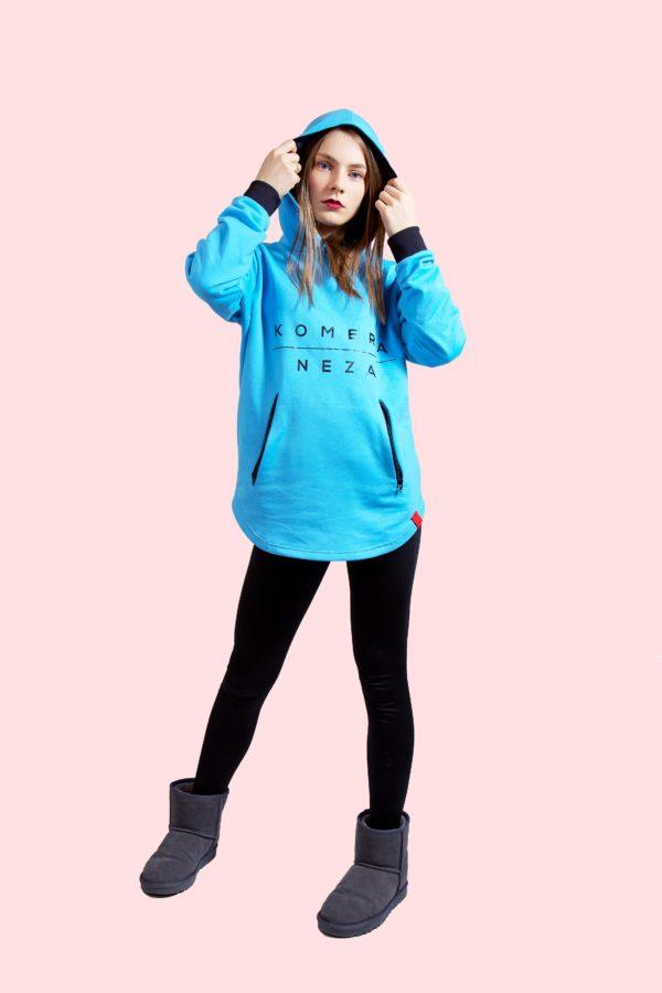 woman wearing blue zipper hoodie with black komera neza print logo