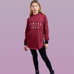 kid wearing burgundy zipper hoodie with white komera neza print logo
