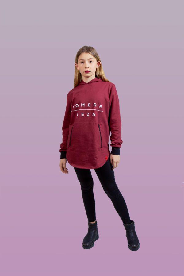 kid wearing burgundy zipper hoodie with white komera neza print logo