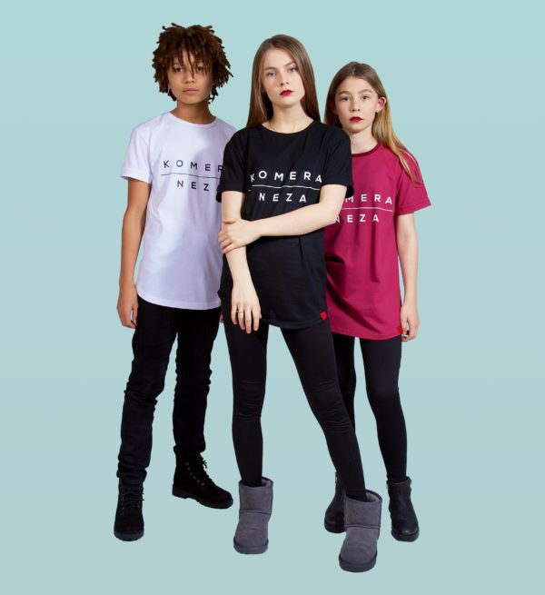 kids wearing white, black, and burgundy t-shirts with komera neza print logo