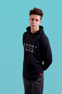 man wearing black zipper hoodie with white komera neza print logo