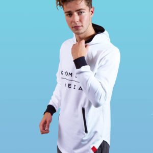 man wearing white zipper hoodie with black komera neza print logo