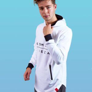 man wearing white zipper hoodie with black komera neza print logo