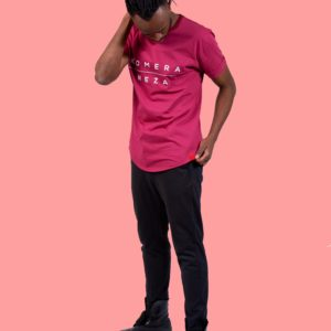 black male wearing burgundy t-shirt with white komera neza print logo