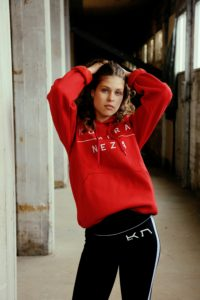 womens red hoodie with white komera neza print logo