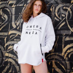 woman wearing white zipper hoodie with black komera neza print logo