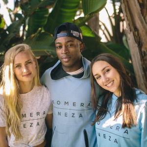 Three people in the wild wearing clothes from KOMERA NEZA