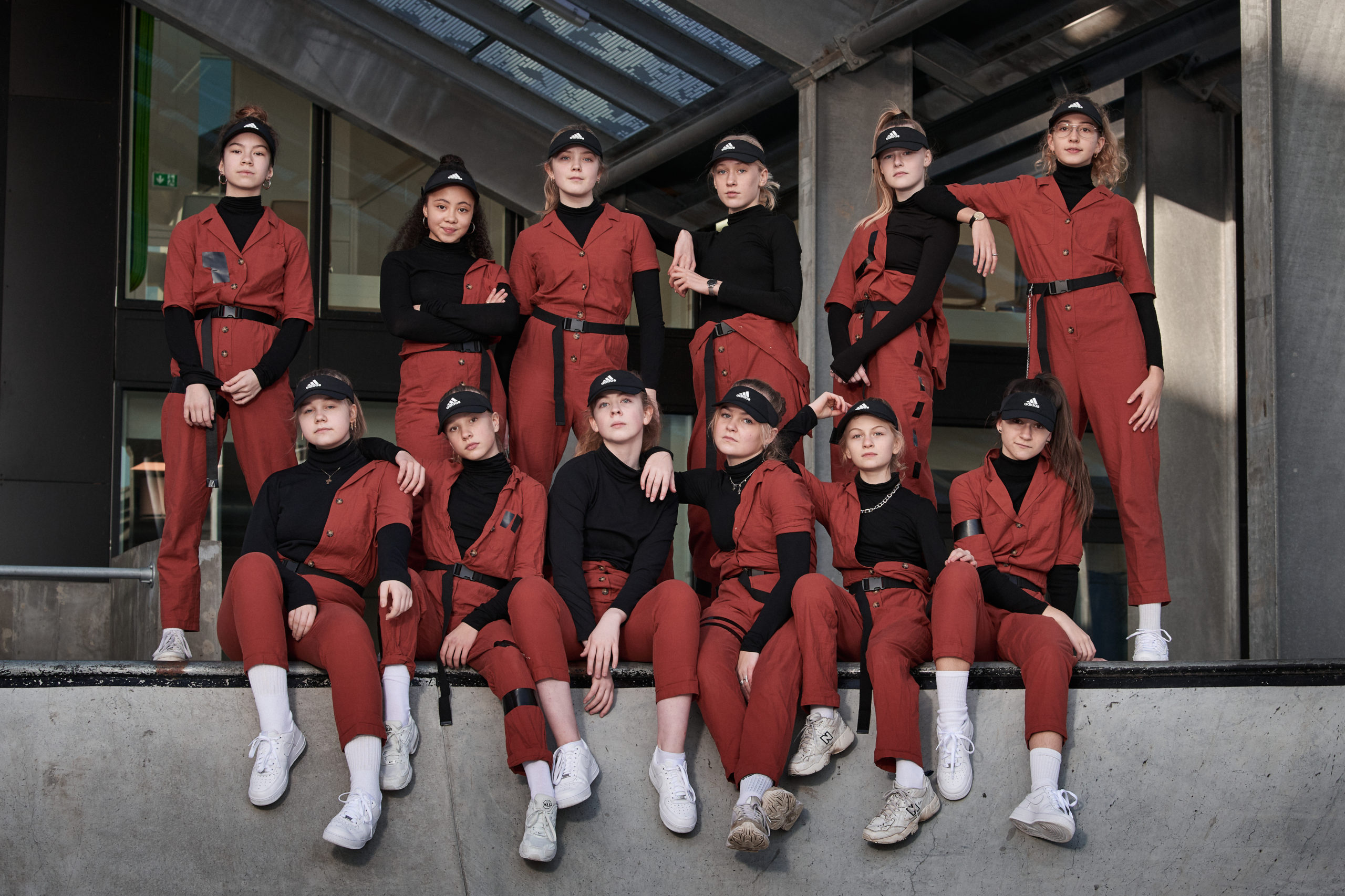 group of ladies wearing matching red and black outfits