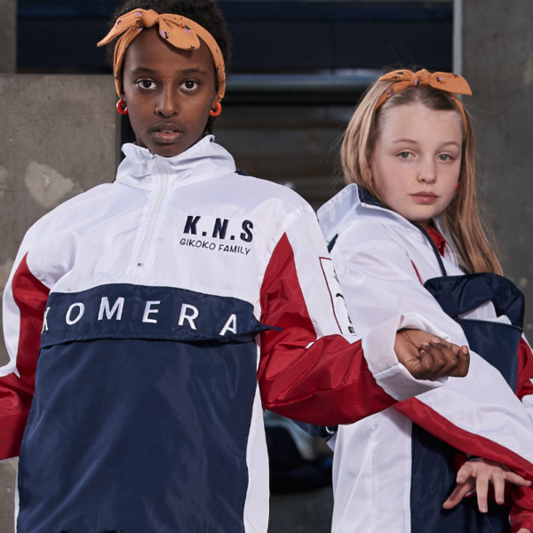 two kids wearing white komera neza jackets