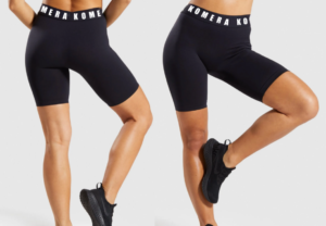black tights shorts with white komera neza logo