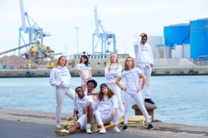 group wearing white t-shirt and hoodie with black logo