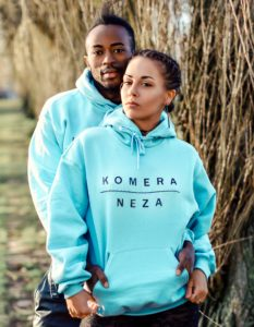 two models wearing baby blue hoodie with black komera neza print logo