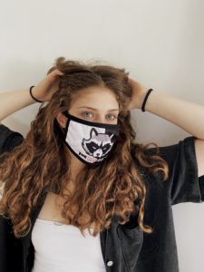 woman in back face mask with raccoons logo