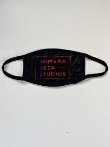 black KOMERA NEZA STUDIOS face mask