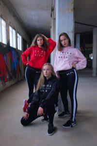 womens red black and pink logo hoodie with white komera neza print logo