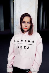 womens pink logo hoodie with black komera neza print logo