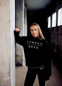 womens black logo hoodie with white komera neza print logo